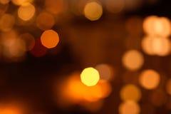 Guld och bruntbokehbakgrund Arkivbilder