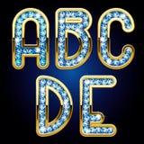 Guld- och diamantalfabetbokstäver Arkivbilder
