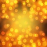 Guld och orange feriebokeh Arkivfoton