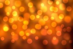 Guld och orange feriebokeh Royaltyfri Fotografi