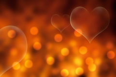Guld- och orange valentin dagbakgrund Royaltyfria Foton
