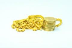 Guld och pengar arkivbild