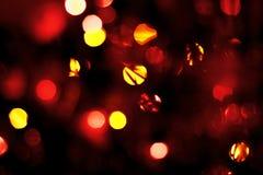 Guld och röda ljus blänker Arkivbild