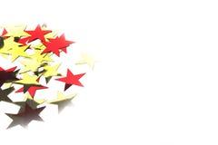 Guld- och röda metalliska stjärnor Royaltyfri Fotografi