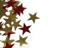 Guld- och röda metalliska stjärnor Arkivfoto