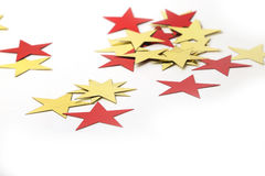 Guld- och röda metalliska stjärnor Fotografering för Bildbyråer