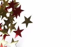 Guld- och röda metalliska stjärnor Royaltyfri Foto