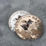 Guld- och silverbrexitmynt Royaltyfria Bilder