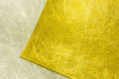 Guld- och silverfibertextur Arkivfoton