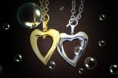 Guld- och silverhjärta Royaltyfri Foto