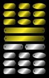 Guld- och silvermetallplattor Arkivfoto