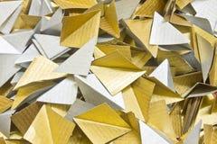 Guld- och silverpapper Arkivbilder