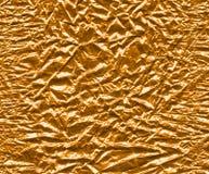 Guld- omkullkasta Arkivfoton