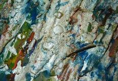 Guld- orange bakgrund för blåa grå färger som mousserar lerig vaxartad målarfärg, kontrast formar bakgrund i pastellfärgade toner arkivbild