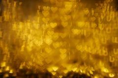 Guld- ord` älskar jag dig `-bokehbakgrund Fotografering för Bildbyråer
