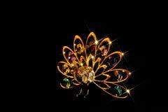 guld- påfågel royaltyfri foto