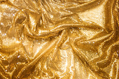 Guld- paljetter - moussera den sequined textilen royaltyfria foton