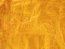 Guld- pappers- texturbakgrund arkivfoton