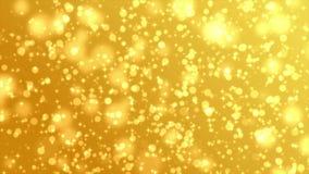 Guld- partikelbakgrund arkivfilmer