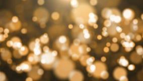 Guld- partiklar för abstrakt bokeh stock video