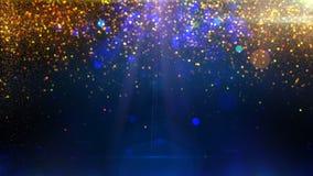Guld- partiklar på blå bakgrundsögla arkivfilmer