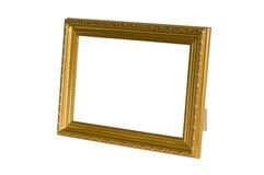 Guld- photoframe Arkivfoton