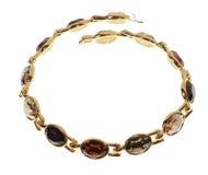 Guld pläterad halsband på en vit bakgrund Royaltyfri Bild