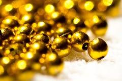 guld- plast- ii för bakgrundspärla Arkivbild