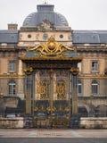 Guld- port av slotten av rättvisa i citeraön i Paris, Fr Fotografering för Bildbyråer