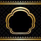 Guld- prydnad på svart bakgrund med ramen Arkivbilder