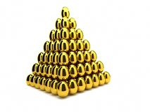 guld- pyramid för ägg Arkivfoto