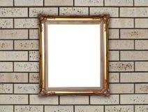 Guld- ram på tegelstenstenväggen Arkivfoton