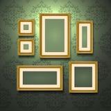 Guld- ramar på väggen vektor illustrationer