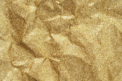 Guld rynkad pappers- texturabstrakt begreppbakgrund Royaltyfria Bilder