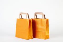 Guld- shoppingpåsar arkivfoto