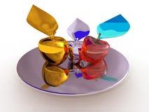 Guld-, silver- och exponeringsglasäpplen på en silverplatta Arkivfoton