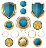 Guld- sköldar, etiketter och lager, blå upplaga Royaltyfria Bilder