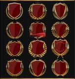 Guld- sköldar, etiketter och lager, mörker - röd upplaga Royaltyfri Bild