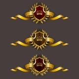 Guld- sköldar med lagerkransen Royaltyfria Bilder