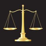 Guld skalar symbolen Arkivfoto