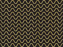 Guld- skimra vågmodellen Arkivfoton