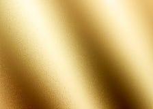 Guld- skinande abstrakt metallisk texturerad bakgrund Arkivbild