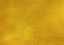 Guld- skinande abstrakt metallisk texturerad glass bakgrund Arkivbild