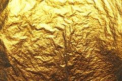 Guld- skinande bakgrund Ljus guld- bakgrund, mousserar och Arkivbilder