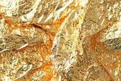Guld- skinande bakgrund Ljus guld- bakgrund, mousserar och Royaltyfria Foton