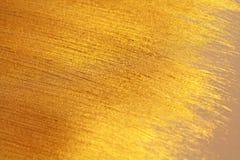 Guld- skinande bakgrund Ljus guld- bakgrund, mousserar och Arkivbild