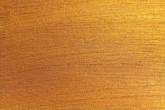 Guld- skinande bakgrund Ljus guld- bakgrund, mousserar och Royaltyfria Bilder