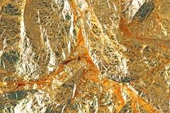 Guld- skinande bakgrund Ljus guld- bakgrund, mousserar och Arkivfoto