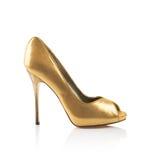 Guld- sko för trendiga kvinnor Arkivbilder