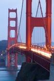 guld- skymning för broport royaltyfria foton